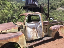 Old truck with bullet holes in front of an abandoned mercury mine Santa Barbara County