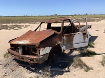 Old ute left on mud flats used to be a government vehicle