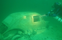 Old Volkswagen at the bottom of Lake Walchensee Bavaria Photo by Achim R Schloeffel
