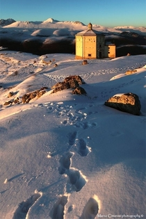 Old Watchtower in the snow  by unknown