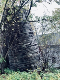 Old wooden silo at an abandon farm in Northern New York on a grey day Wish the lighting had been better