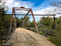 Older Infrastructure Iron Bridge with Wooden Deck southeast of Wichita KS