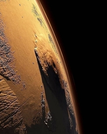 Olympus Mons on Mars the largest volcano in the solar system  almost  times higher than the Everest Bet in what year a human will first reach the top of Olympus Mons  Picture by NASA