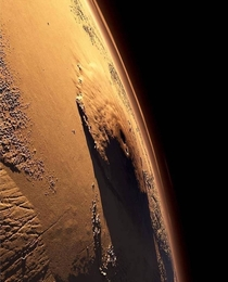 Olympus Mons the largest volcano in the Solar System casts a huge shadow on Mars
