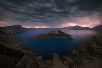 Ominous storm clouds gather as thunder rumbles over Crater Lake National Park OR