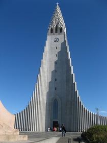 On a hilltop near Reykjavk the Hallgrmskirkja is one of the citys best-known landmarks and is visible throughout the city Architect Gujn Samelssons design of the church was commissioned in  He is said to have designed it to resemble the trap rocks mountai