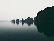 On a junk boat I woke up in this magical and eerie ancient place - Bai Tu Long Bay Vietnam