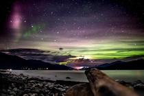 On a random overnight canoe trip the skies rewarded us with these crazy colors while heavy lightning was striking at the end of the lake Thank you Northern Lights  Kootenay Lake British Columbia