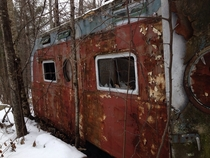 On a snowmobile trip I found an abandoned mobile home in the woods