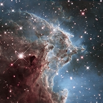 On its th anniversary Hubble snapped this awesome infrared-light portrait of the Monkey Head Nebula