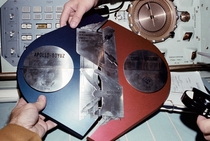 On July   the Apollo-Soyuz Test Project was successfully carried when an American and a Soviet spacecraft docked in LEO After their famous handshake the crew members assembled this commemorative plaque written in both Russian and English
