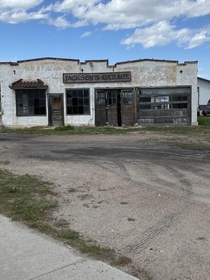 On my journey on foot across America I came by this old Truck shop still has a truck inside