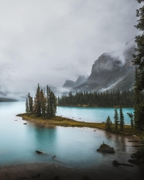 On my last day in Jasper I took a boat out to Spirit Island The entire ride was through dens fog and pouring rain By the time we hit shore we got a  minute window where the mountains made an appearance Worth it Maligne Lake Jasper CA  IG kylefredrickson