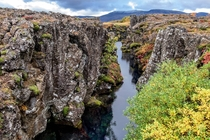 On one side Euroasia tectonic plate on the other - The North American Sylfra Iceland