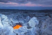 On the lava field - the orange glow of hot molten rock beneath Kamchatkas volcanic hellscape  photo by