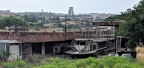 Once envisioned to ferry passengers across the manmade lake this craft in urban Yerevan now sits disused in front of a dilapidated boathouse