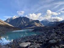 Once the sun is blocked by the mountain the temperature drops  degrees near this glacier fed lake End of October in Alaska