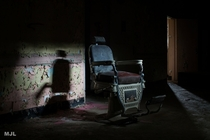 one of a kind  year old barber chair in abandoned psychiatric hospital