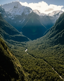 One of many valleys being over shadowed by the monstrous peaks in Fiordland New Zealand x