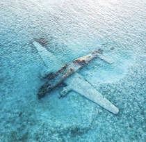 One of Pablo Escobars Drug Smuggling Planes That Missed the Runway and Crashed on a Sandbar in the Bahamas and Left Abandoned Since