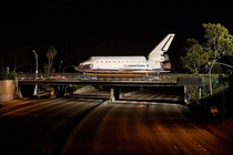 One year ago today Interstate  is shut down temporarily as the Space Shuttle Endeavour Orbiter crosses the Manchester Blvd overpass on its way to its final home at the California Science Center museum - Los Angeles CA