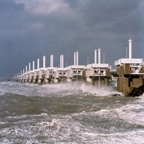 Oosterscheldekering Eastern Scheldt storm surge barrier at work during a storm