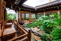Open courtyard and garden of a tea house in the historic Bukchon Hanok Village Jongno District Seoul South Korea