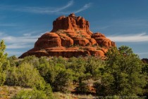 Orange blue and green make a beautiful scene Bell Rock in Sedona early AM