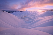 Oregons Painted Hills under a pristine coat of snow  Photo by Alex Noriega xpost from rUnitedStatesofAmerica