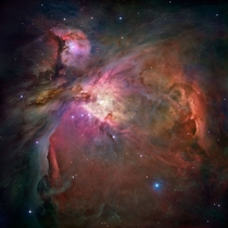 Orion Nebula photographed by the Hubble Telescope More than  stars of various sizes appear in this image some of which have never been seen in visible light Photo credit M Robberto