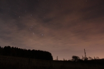 Orion shines through some high cloud on a freezing cold Scottish night
