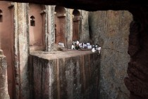 Orthodox Christians sit outside the famous monolithic rock-cut churches during a Good Friday celebration in Lalibela