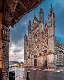 Orvieto Cathedral is a th-century Roman Catholic cathedral completed in  Its facade was designed by the Sienese Lorenzo Maitani