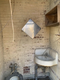 Outdoor bathroom with major SCP  vibes