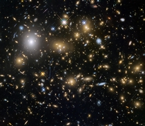 Over five billion light years away MACSJ is one of the largest and oldest galaxy clusters ever observed Image credit NASAHubble ESA and the HST Frontier Fields team STScI