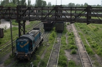 Overgrown but still-used train tracks in ArcelorMittal Steel Combine in Kryvyi Rih Ukraine this time closer up