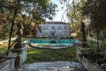 Overgrown villa with wall paintings inside italy