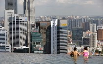 Overlooking Singapores financial district from a rooftop infinity pool