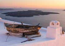 Overlooking the Aegean Sea from a rooftop in Santorini Greece  Photo by Igor Ivanov