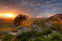 Overlooking the open moorland sunset on Yar Tor UK  by Gary King