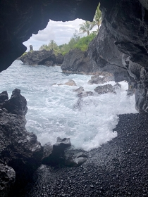 Pacific Ocean as seen from inside a lava tube on Maui HI