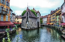 Palais de lIle castle is a stunning sight in the storybook town of Annecy France