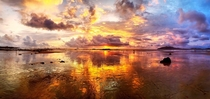 Pano shot  Tamarindo Costa Rica Sunset reflected against the receding tide