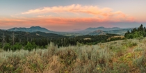 Panorama of colorful clouds arching perfectly over a valley in the Portneuf Range in SE Idaho USA