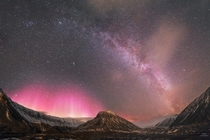 Panorama of the Milky Way and Aurora Borealis over Svalbard
