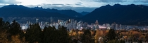Panorama of the Vancouver skyline surrounded by mountains and autumn coloured trees