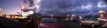 Panoramic picture of dark stormy clouds to beautiful colorful sky