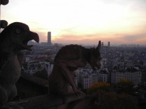 Paris France the Notre Dame gargoyles guard at sunset