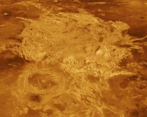 Part of Alpha Regio is shown in this three-dimensional perspective view of the surface of Venus Alpha Regio a topographic plateau approximately  kilometers in diameter The simulated hues are based on color images recorded by Soviet Venera  and  ships