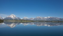 Part of the Teton Range reflected in Jackson Lake - Grand Teton National Park
